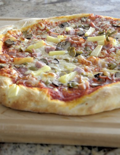 Hawaiian pizza with puffy golden crust