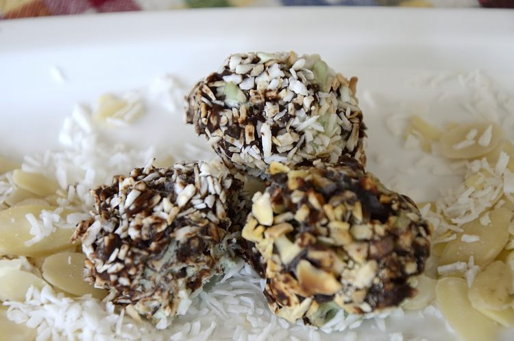 3 ice cream truffles coated in chocolate and toasted coconut and toasted almonds