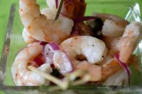 Jumbo shrimp in juicy marinade with skewers