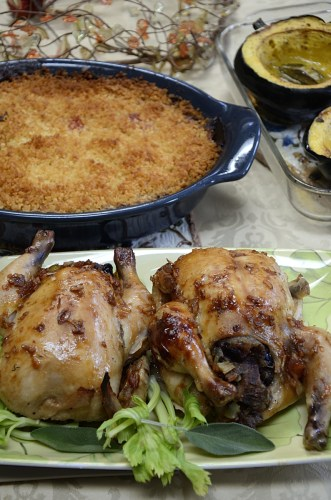Table setting Cornish hens, stuffed with Root Vegetable casserole and baked squash.