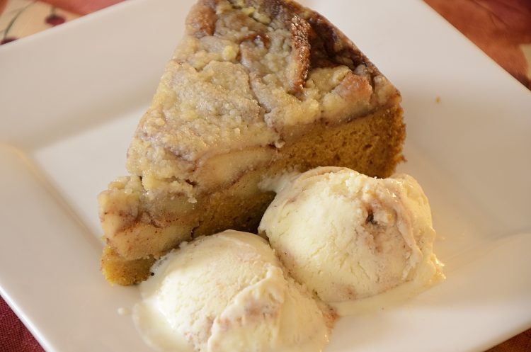 Slice of pumpkin apple streusel cake with apple cider ripple ice cream on the side.