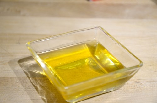 Golden, clear ghee in a small saucer.