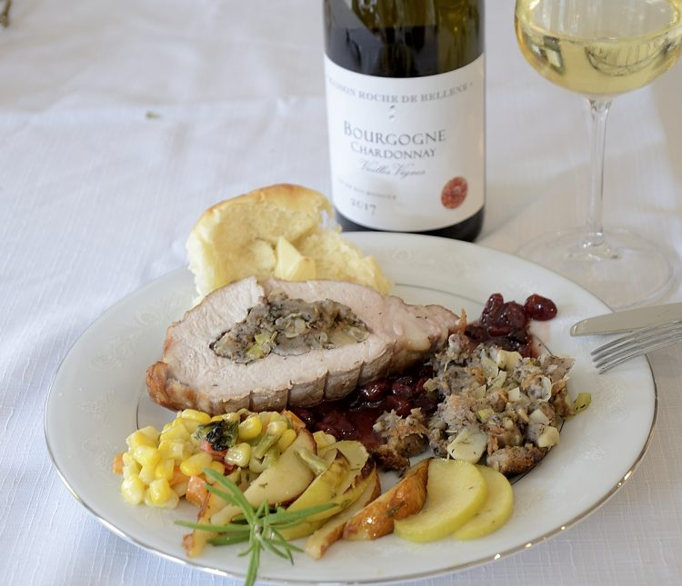 Plate with Stuffed pork loin roast, port cranberry sauce, Fall corn salad and broiled apples and pears.