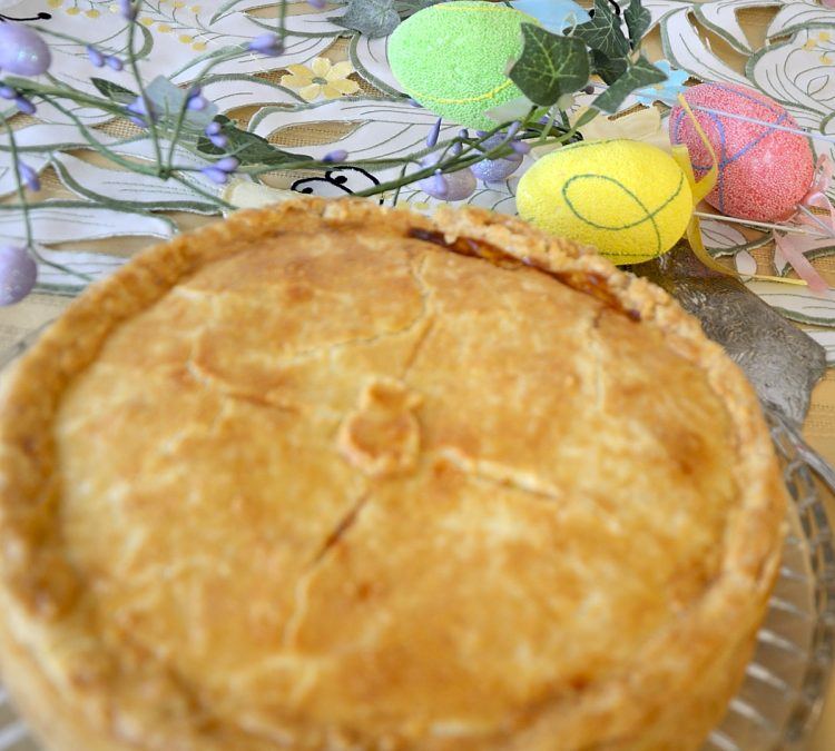 Golden Italian Easter Pie on a serving platter.