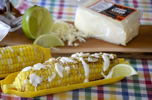Corn on the cob garnished with mexican spices, grated cheese and mexican crema.