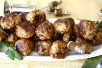 Crispy, browned lemon turkey meatballs on a platter with serving picks. s