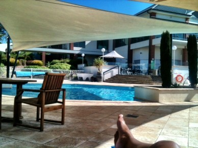 Laying by the Novotel pool
