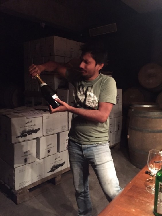Abhay Rajaria winemaker at Grover Zampa, opening a bottle of sparkling wine, Chenin Blanc, Nashik Valley, Maharashtra, India, Indian wine