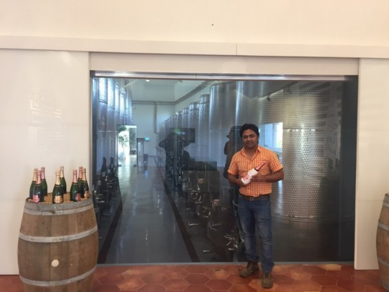 winemaker Amrut Vare, with a bottle of Chandon India overlooking the stainless steel tank room, Nashik Valley, Maharashtra, Indian Wine
