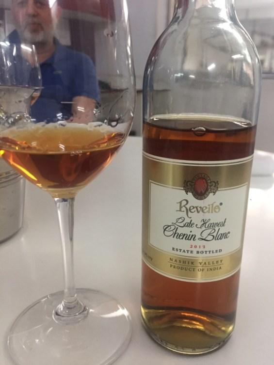 a glass of late harvest Chenin Blanc by Reveilo Winery, Nashik Valley, Maharashtra, India, Indian Wine