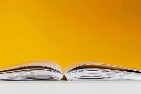 white book in white table near yellow wall mental health glossary
