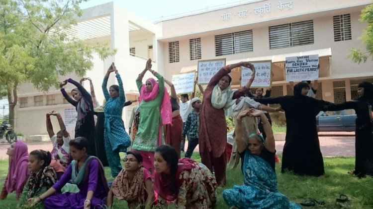 Bhopal survivors strike Yoga postures on Saturday outside the abandoned Yoga centre originally built for their treatment in Bhopal. Photo: BGPMSS
