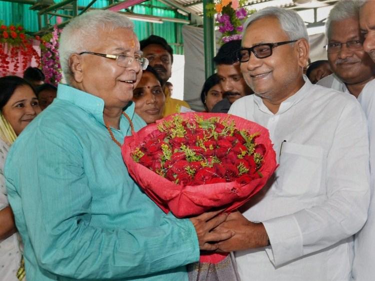 Bihar Chief Minister Nitish Kumar greeting RJD chief Lalu Prasad on his 68th birthday in Patna on Thursday. PTI Photo