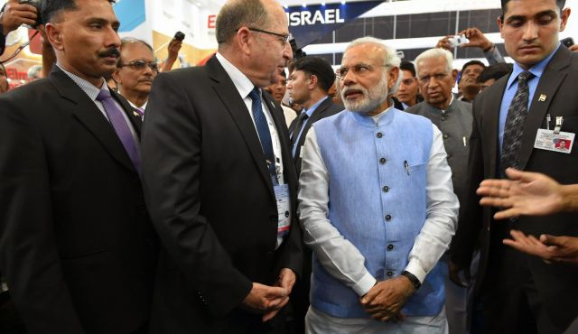 Israeli Defence Minister Moshe Ya'alon and Prime Minister Narendra Modi at the Israel Aerospace Industries pavilion during the Bangalore air show earlier this year. Credit: IAI