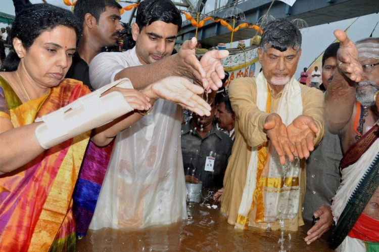 Chief Minister of Andhra Pradesh N Chandrababu Naidu along with his family offering prayers during the first day of Godavari Pushkaram festival in Rajahmundry on Tuesday. PTI Photo