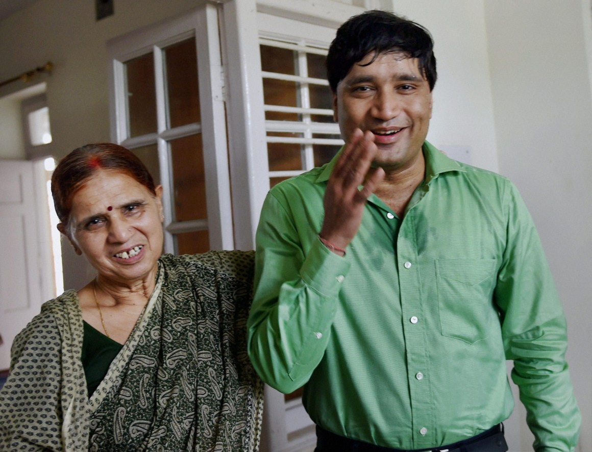 Bureaucrat Sanjiv Chaturvedi with his mother after getting news of his Magsaysay Award on Wednesday. Credit: Subhav Shukla, PTI