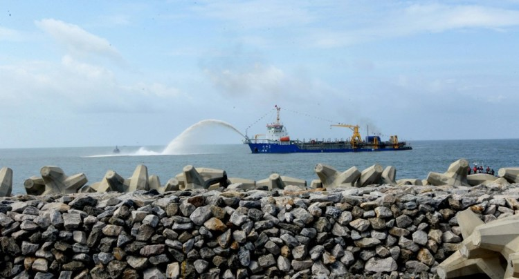 """Photo of marine sand being pumped by a ship at the commencement of """"Colombo Port City"""" at the Colombo, September 2014. Credit: Flickr/Mahinda Rajapaksa CC 2.0"""