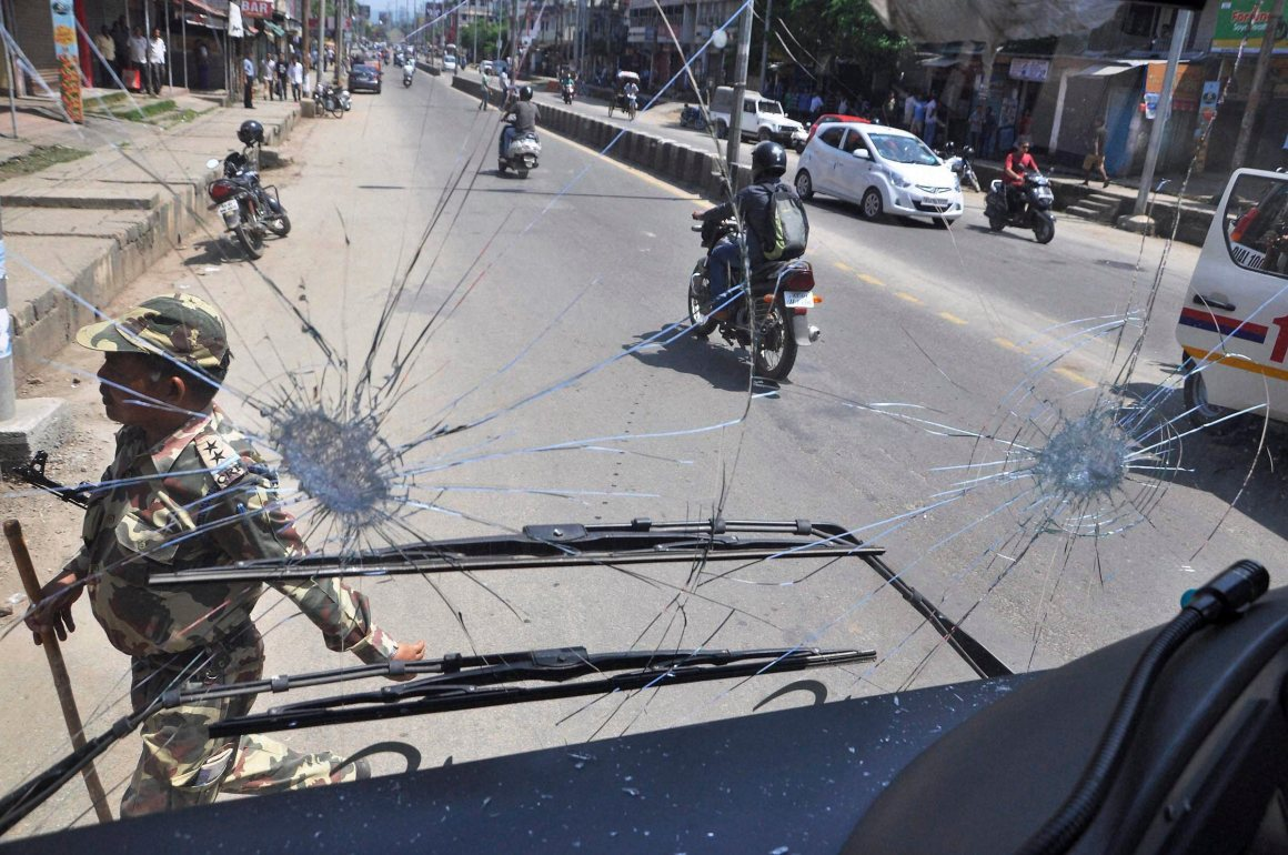 Guwahati: Activists of the AJYCP vandalise an Assam State Transport Corporation bus during the 12-hour Assam bandh in Tinsukia. Credit: PTI Photo