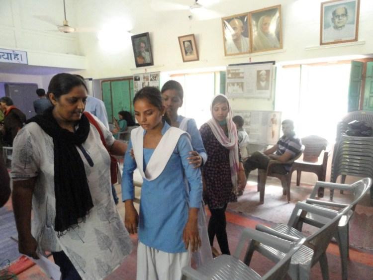 Manisha Saini of class X still finds it difficult to walk due to injuries. Credit: