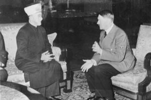 "The Grand Mufti of Jerusalem, Amin al-Husseini, met with Adolf Hitler in 1941. Credit: Bundesarchiv Bild 146-1987-004-09A, Amin al Husseini und Adolf Hitler"" by Bundesarchiv, Bild 146-1987-004-09A / Heinrich Hoffmann, CC BY-SA"