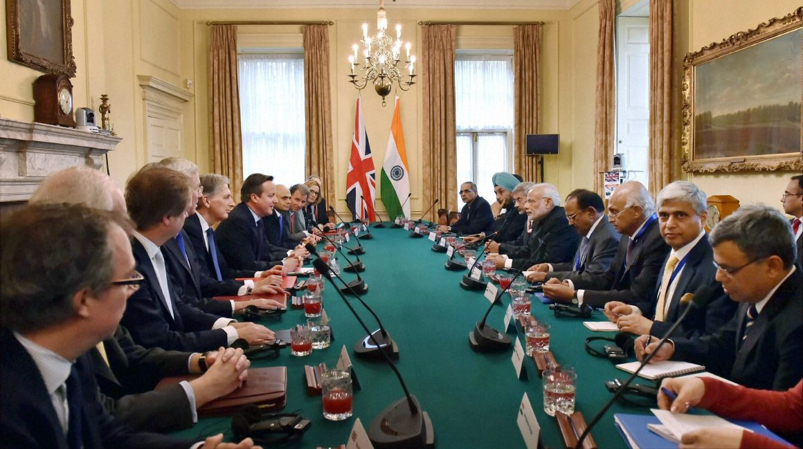 Prime Minister Narendra Modi and his British counterpart David Cameron during their delegation level meeting at 10 Downing Street in London on Thursday. Credit: PTI Photo by Vijay Verma