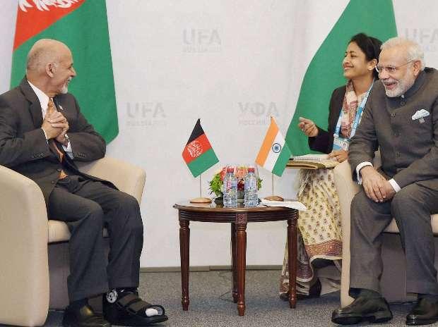 Prime Minister Narendra Modi and Afghan president Ashraf Ghani share a lighter moment together at Ufa, Russia , July 10, 2015. credit: PTI