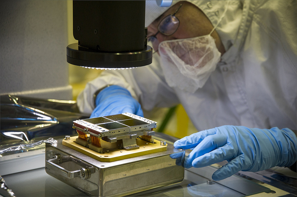 A technician aligns a replacement focal-plane assembly with a powerful three-dimensional microscope at NASA's Goddard Space Flight Centre in Greenbelt, Md. This FPA will be installed on the Near Infrared Camera instrument, the James Webb Space Telescope's principal imager. Credit: NASA/Goddard/Chris Gunn.