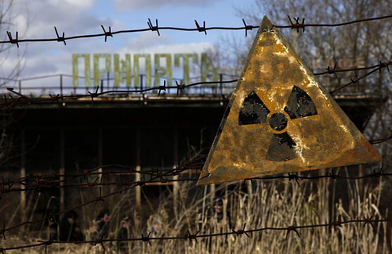 A radioactive sign hangs on barbed wire outside a café in Pripyat. Credit: Wikimedia