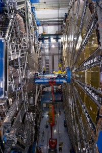 Engineers installing the beam pipe (within which particles are accelerated and collided) inside the gigantic ATLAS detector. Credit: CERN
