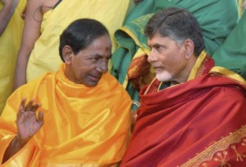 Andhra Pradesh Chief Minister N Chandra Babu Naidu in conversation with Telangana Chief Minister K Chandrasekhar Rao during the Chandi Yagam at Medak district of the state on Sunday. Credit: PTI