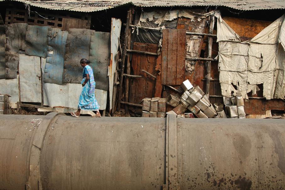 An Unequal Path. Under the Mahim-Bandra Bridge at Dharavi's Sanaullah Compound. Credit: Meena adri/Flickr CC 2.0