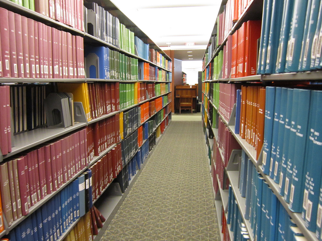 A rainbow of journals in a library at the University of North Caroline. Credit: moonlightbulb/Flickr, CC BY 2.0