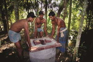 A family in Sirajganj district in Bangladesh installing sanitary latrine. Credit: Development Organization for the Rural Poor/The Third Pole