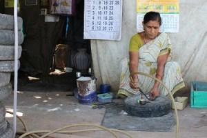 K Latha of Theni, repairing punctured tyres. Credit: Sandhya Ravishankar