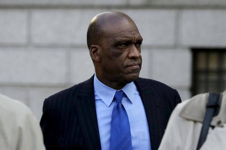 John Ashe, a former United Nations General Assembly president and UN ambassador from Antigua and Barbuda, exits the Manhattan US District Courthouse in New York, December 10, 2015. Credit: Reuters/Brendan McDermid
