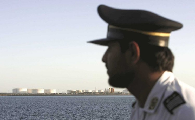 An Iranian guard looks on at oil docks at the port of Kalantari in the city of Chabahar, 300km (186 miles) east of the Strait of Hormuz. Credit:  REUTERS/RAHEB HOMAVANDI
