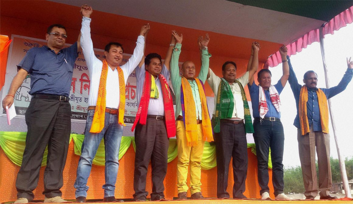 Bodoland People's Front chief Hagrama Mahilary with other party leaders wave their hands during an election rally at Tamulpur in Nalbari district of Assam on Thursday. Credit: PTI Photo