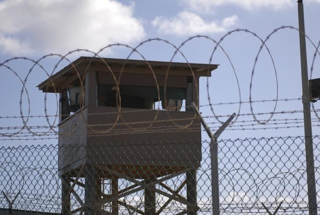 A soldier stands guard in a tower overlooking Camp Delta  at Guantanamo Bay naval base. Credit: Reuters