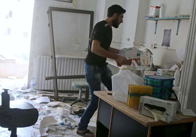 A man removes medicine inside the Medecins Sans Frontieres (MSF)-backed al-Quds hospital after it was hit by airstrikes, in a rebel-held area of Syria's Aleppo, April 28, 2016. Credit: Reuters/Abdalrhman Ismail/Files
