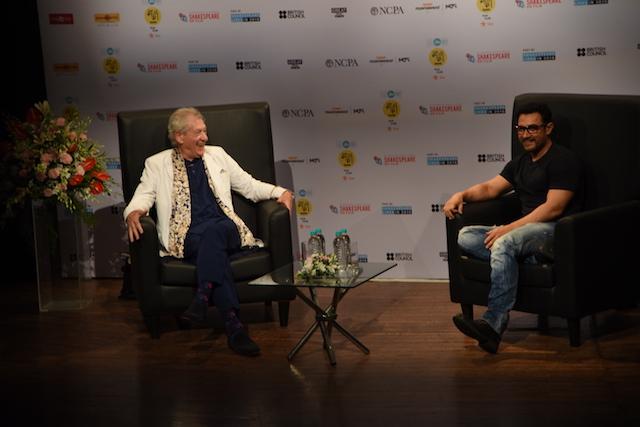 Aamir Khan talks to Sir Ian McKellen in Mumbai on Monday.