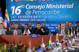 Venezuela's President Nicolas Maduro (C) speaks during the 16th PetroCaribe Ministerial Council in Caracas May 27, 2016. Credit: Miraflores Palace/Handout via Reuters
