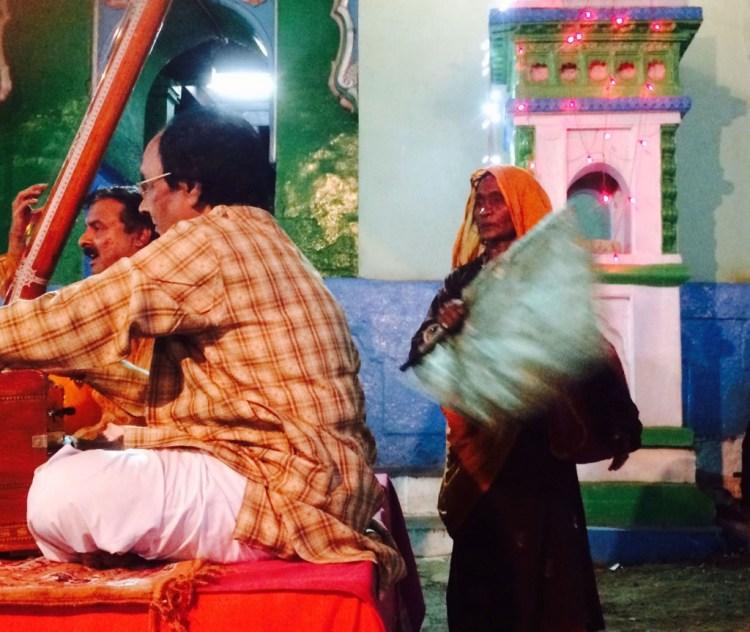A fakira fans the musicians during the concert. Credit: Nikhil Inamdari