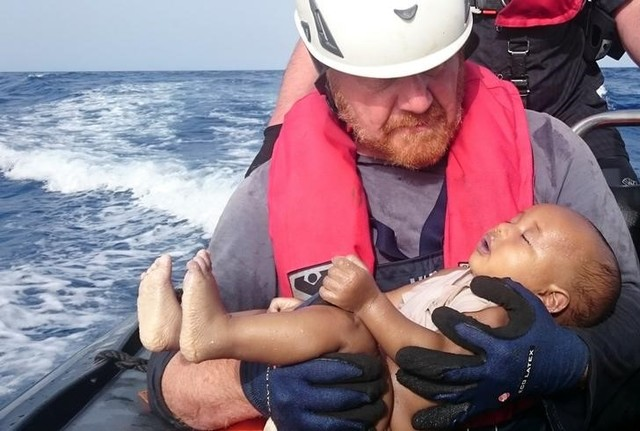 A German rescuer from the humanitarian organisation Sea-Watch holds a drowned migrant baby, off the Libyan cost May 27, 2016. Credit: Christian Buettner/Eikon Nord GmbH Germany/Handout via Reuters