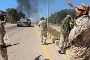 Soldiers from a force aligned with Libya's new unity government walk along a road during an advance on the eastern and southern outskirts of the Islamic State stronghold of Sirte, in this still image taken from video on June 9, 2016. Credit: Reuters TV