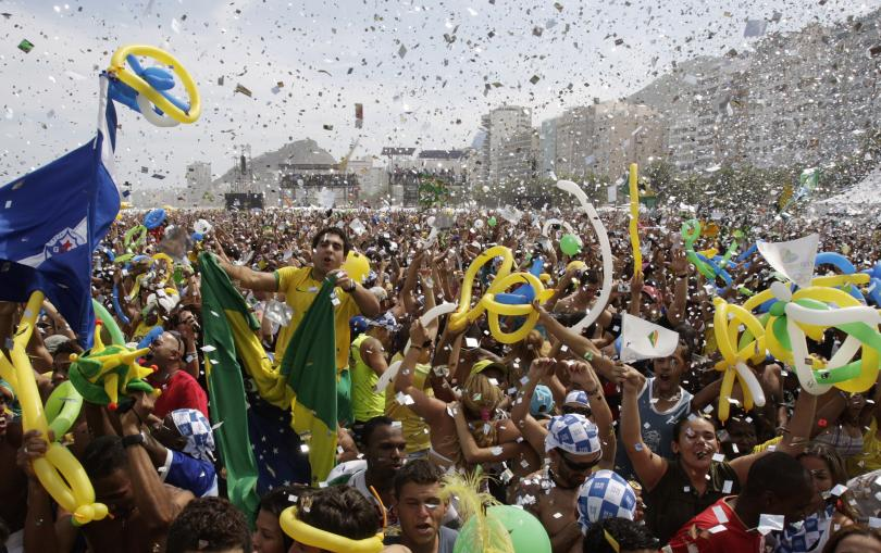 Brazil Residents celebrate after Rio de Janeiro won the bid to host the 2016 Summer Olympic Games. Credit: Reuters