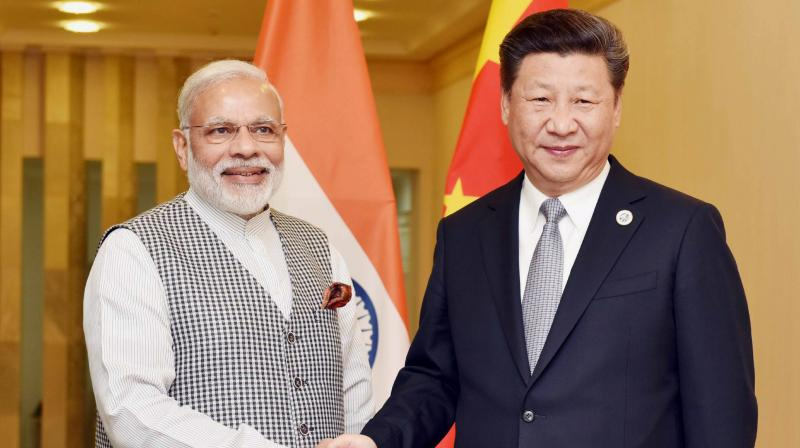 Prime Minister Narendra Modi and Chinese President Xi Jinping. Credit: PTI