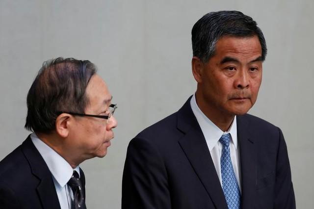 Hong Kong Chief Executive Leung Chun-ying (R) and Secretary for Security Lai Tung-kwok hold a news conference in Hong Kong June 20, 2016. Credit: Reuters/Bobby Yip