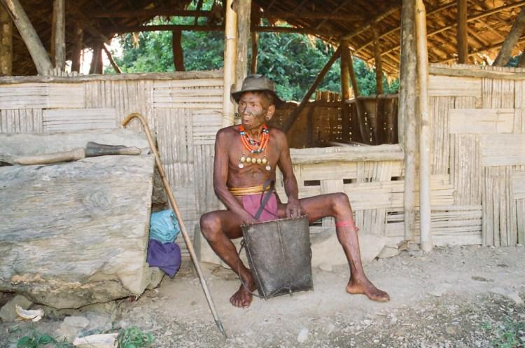 A Konyak man outside his home. Credit: Rupa Chinai