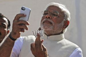 Selfie Governance: The Modi government, which has proven to be adept at adapting to social media, needs a well-thought strategy on how to integrate the medium with governance. Credit: PTI