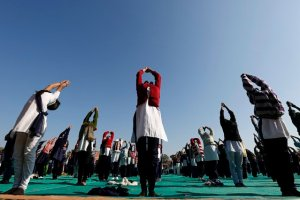 Schoolchildren offer prayers to Sun god during a yoga session at a camp in the western Indian city of Ahmedabad January 6, 2015. Credit: Reuters/ Amit Dave